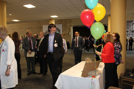 Development Office staff members greet employees as they enter the Levin Hall Auditorium.